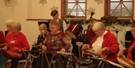 People playing dulcimers at the Senior Center